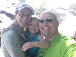 Kelsey, Rayleigh, Kevin in front of the waterfall at Ticonderoga, NY.