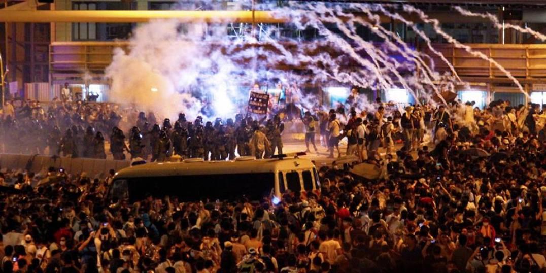 Police firing tear gas (Photo by Dan Garrett)