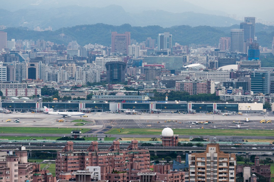 Songshan Airport is located within downtown Taipei. By Wei-Te Wong on Flickr, CC BY-SA 2.0
