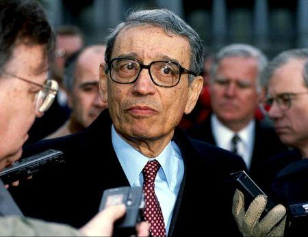 U.N. Secretary-General Boutros Boutros-Ghali is surrounded by members of the media as he leaves the White House after meeting U.S. President Bill Clinton, in this February 23, 1993 file picture. REUTERS/Stringer/Files