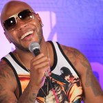 Flo Rida laughing with the cast