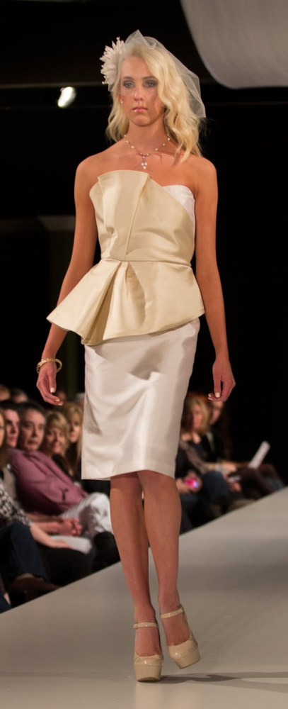 {Model Lily Anderson sold me on this beautiful Katie Lee number. I like the mix of cream and white and the voluminous peplum top. Katie Lee's tailoring was gorgeous.}