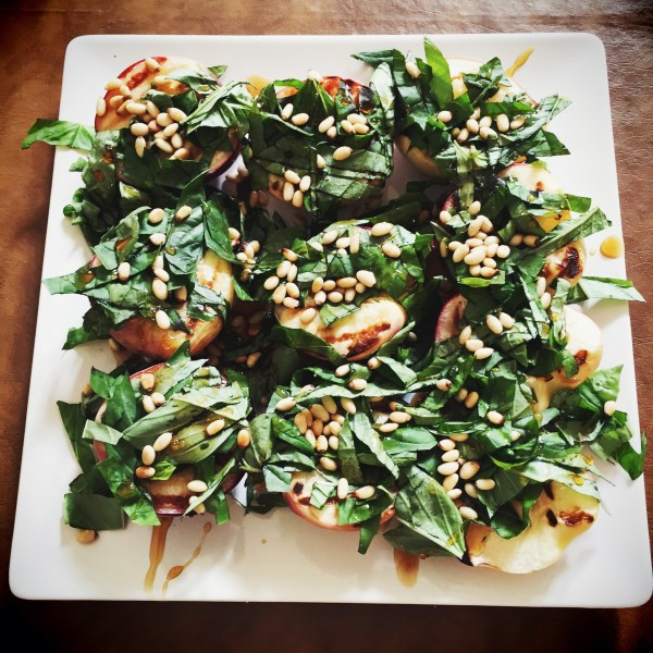 grilled white peach salad with basil & pine nuts