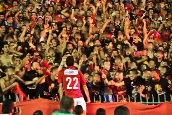 Aboutrika celebrates with fans in Cairo final