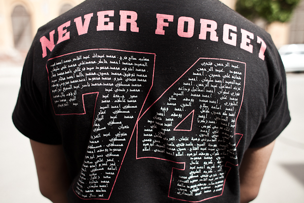 Cairo, Egypt, April 2012: Ultra wearing a shirt that lists all names of the 74 people that died in Port Said.