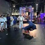 Jonathan demonstrating a judo throw with Flavio Canto.