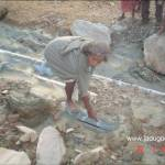 old man showing the burst pipe-