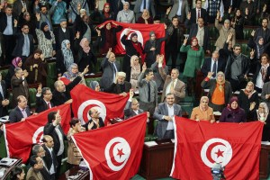 "FILE - In this Sunday, Jan. 26, 2014 file photo, members of the Tunisian National Constituent Assembly celebrate the adoption of the new constitution in Tunis, Tunisia. A Tunisian democracy group won the Nobel Peace Prize on Friday for its contributions to the first and most successful Arab Spring movement. The Norwegian Nobel Committee cited the Tunisian National Dialogue Quartet ""for its decisive contribution to the building of a pluralistic democracy"" in the North African country following its 2011 revolution. (AP Photo/Aimen Zine, File)"