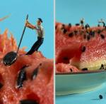 little people as construction workers attempting to pick seeds out of watermelon