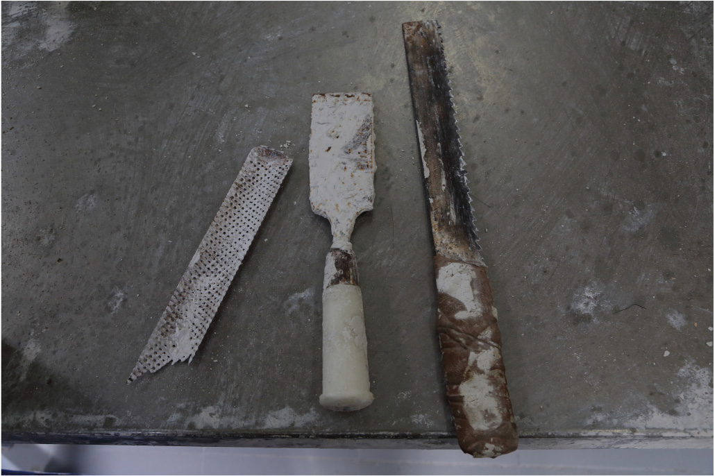 Close up of tools used for casting and sculpting the plaster mold of the artificial limb.