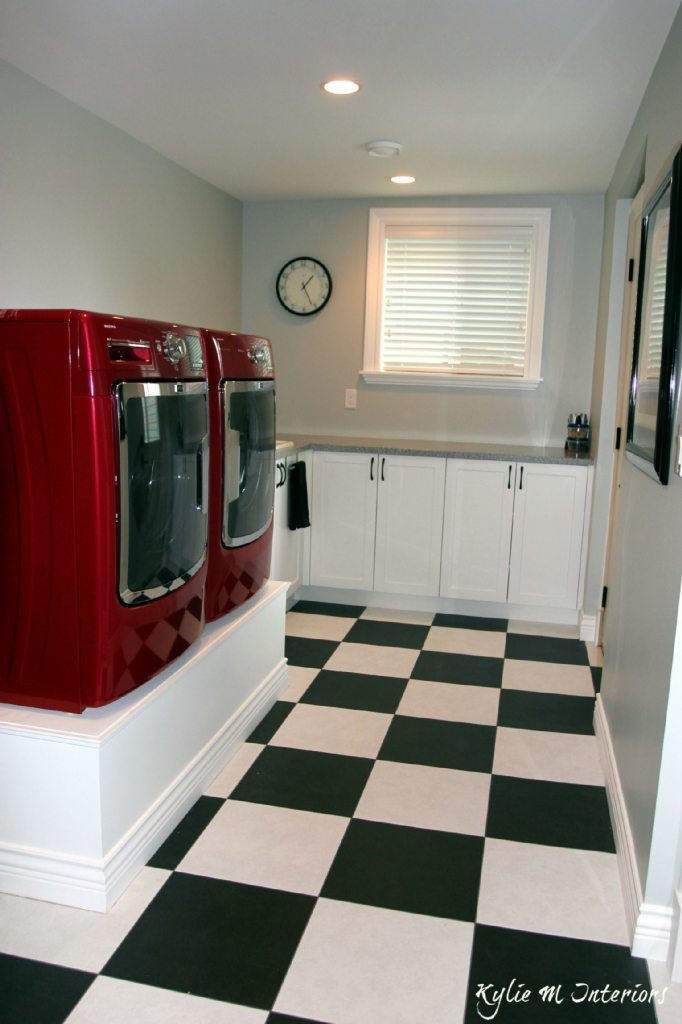 Laundry Room With Red Washer And Dryer And Black And White