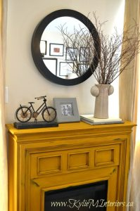 painted electric fireplace using van gogh yellow chalk paint and distressing with dark wax
