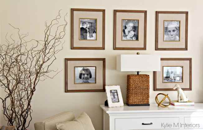 Family photo gallery wall beside the TV. Home Decor and Benjamin Moore Gentle Cream walls