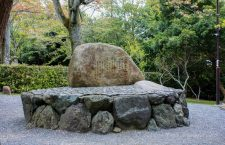"The stone commemorating Zhou Enlai's visit to Arashiyama. He was moved by the cherry blossoms and mountain greenery. The four poems Zhou Enlai wrote about his visit are engraved on a stone monument: ""Arashiyama in the Rain"", at Kameyama-kōen."