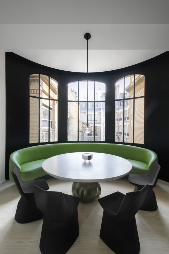'Mars' chairs by Konstantin Grcic for ClassiCon and Eric Schmitt table. Green leather banquette seating designed by François Champsaur