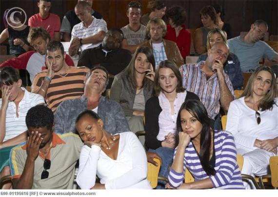 Bored People in Auditorium Seats