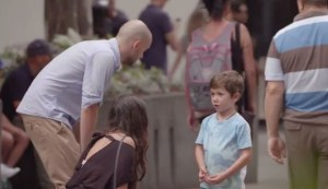 Thousands of people walk past a little boy who 'loses his parents' in a busy shopping centre