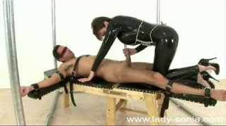 Muscular Young Stud Bound And Ridden In Rubber