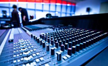 One of the first stops for recording students, the Analog Console lab is centered around sixteen Soundcraft Ghost LE 24-channel analog mixing and recording consoles, housed in Argosy studio furniture. Each station also includes a 24-track hard disk recorder, CD recorder, and outboard signal processing. The lab features a central Pro Tools system, allowing instructors to feed eight channels of audio simultaneously to all stations for recording exercises.