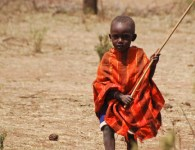A Maasai child, Kenya. Maasai pastoralists in East Africa increasingly find their traditional herding routes blocked by land investors. Photo: Tim Cronin/CIFOR photo