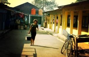 A woman collects water in Pasar Burung, Tangerang. Mo Riza.