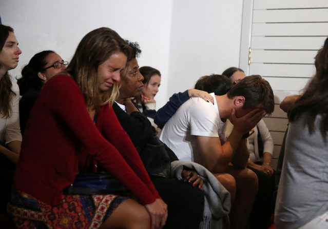 Relatives of Brazilian journalist Guilherme Marques, who died in a plane accident that crashed into Colombian jungle with Brazilian soccer team Chapecoense onboard near Medellin, mourn during a mass in Rio de Janeiro, Brazil, November 29, 2016. REUTERS/Pilar Olivares