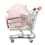 Piggy bank in a shopping trolley