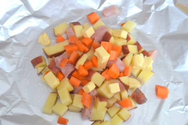Place a couple of handfuls of potatoes, carrots and turkey strips on centre of the foil