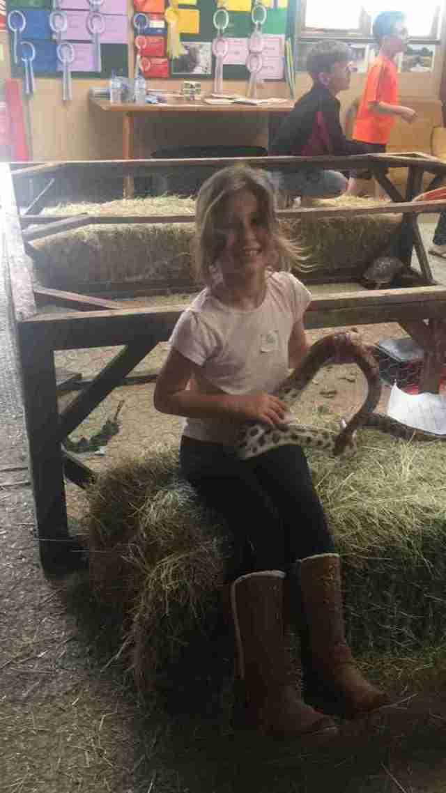 Libby holding snake at Karoben