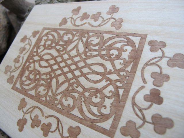 Laser cut and etched Wallnut veneer inlaid into birch wood