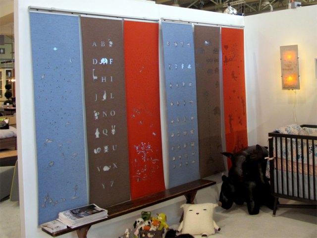 Laser cut merino wool felt window coverings for kids rooms, hanging side by side along with our night lightbox lamp