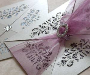 French flair laser cut wedding invitations showing clasp