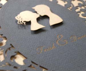 Lovers Cameo laser cut wedding invitations close up of couple in cameo kissing