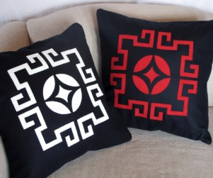 Laser cut throw pillows in white and red