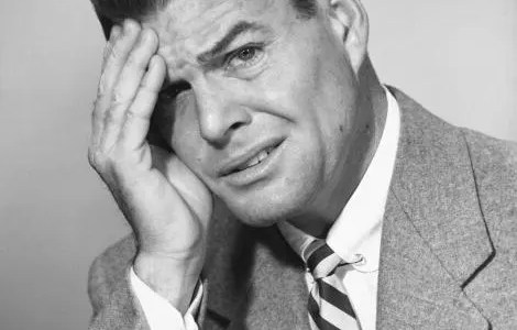 UNITED STATES - CIRCA 1950s:  Portrait of man with headache.  (Photo by George Marks/Retrofile/Getty Images)