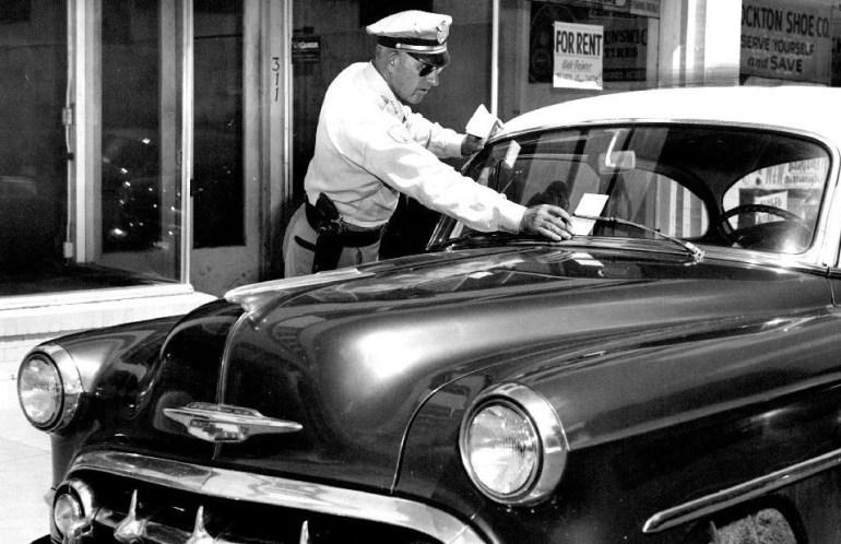 police ticketing car