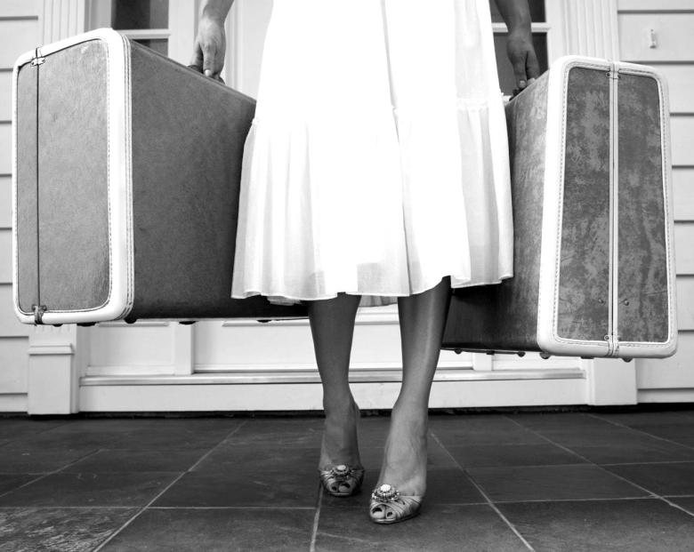woman-with-suitcases-blackwhite