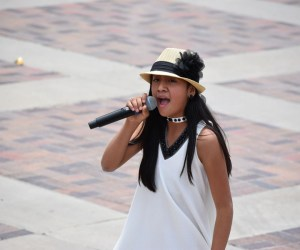 """12 year old Marquel Garcia commanded the stage at the civic center amphitheater Sunday afternoon. She sang """"I Will Always Love You"""" to thousands of festival attendants. When asked about her favorite artists she said she draws inspiration from Whitney Houston. Photo by Antonio Hernandez"""