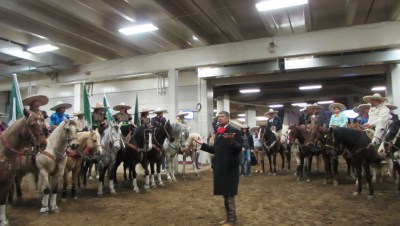 Jerry Diaz, producer of the Mexican Rodeo Extravaganza gives back stage instructions and motivation to participating Charro and escaramuzas (dancing horse riders)