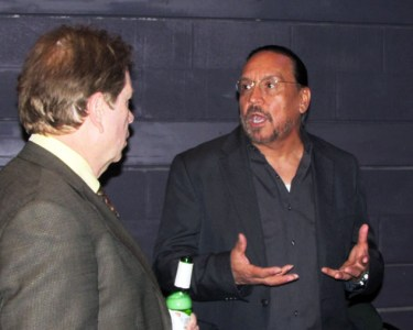 Cinco Decimas playwright Tony Garcia (right) talks with a guest at VIP guest at opening reception April 12
