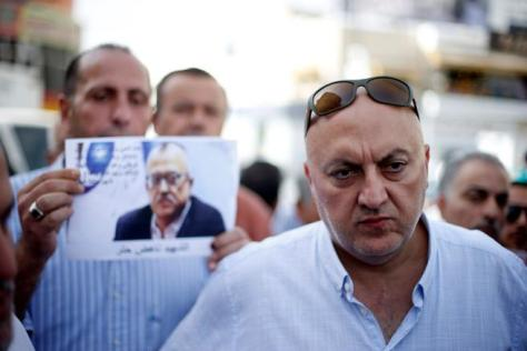 Majed Hattar (R), brother of the Jordanian writer Nahed Hattar, speaks to the media during a sit-in in the town of Al-Fuheis near Amman, Jordan, September 25, 2016. REUTERS/Muhammad Hamed TPX IMAGES OF THE DAY