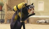 A funny picture of a cat wearing a blue scuba diving suit and equipment.