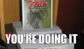 A Wii Zelda Twilight Princess game case inserted in a Super Nintendo. You're doing it wrong.