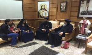 A photo released on Thursday by Diocese of Minya and Abu Qirqas showing the woman who was a victim of the mob attack on Friday meeting with the Priests of the Diocese (Photo: Diocese of Minay and Abu Qirqas)