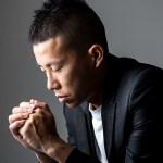 Young man praying to god