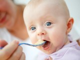 baby being spoon fed