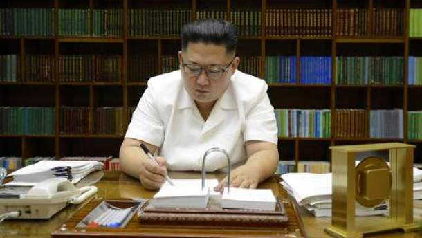 "This July 27, 2017 picture released from North Korea's official Korean Central News Agency (KCNA) on July 29, 2017 shows North Korean leader Kim Jong-Un signing documents for test launch of an intercontinental ballistic missile (ICBM), Hwasong-14 at undisclosed place in North Korea. Kim Jong-Un boasted of North Korea's ability to strike any target in the US after a second ICBM test that weapons experts said could even bring New York into range -– in a potent challenge to US President Donald Trump. / AFP PHOTO / KCNA VIS KNS AND AFP PHOTO / STR / - South Korea OUT / REPUBLIC OF KOREA OUT ---EDITORS NOTE--- RESTRICTED TO EDITORIAL USE - MANDATORY CREDIT ""AFP PHOTO/KCNA VIA KNS"" - NO MARKETING NO ADVERTISING CAMPAIGNS - DISTRIBUTED AS A SERVICE TO CLIENTS THIS PICTURE WAS MADE AVAILABLE BY A THIRD PARTY. AFP CAN NOT INDEPENDENTLY VERIFY THE AUTHENTICITY, LOCATION, DATE AND CONTENT OF THIS IMAGE. THIS PHOTO IS DISTRIBUTED EXACTLY AS RECEIVED BY AFP. /"