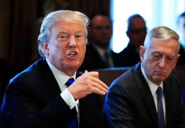 President Donald Trump with Secretary of Defense Jim Mattis, right, speaks during a cabinet meeting in the Cabinet Meeting Room of the White House in Washington, Wednesday, Dec. 6, 2017. (AP Photo/Manuel Balce Ceneta)