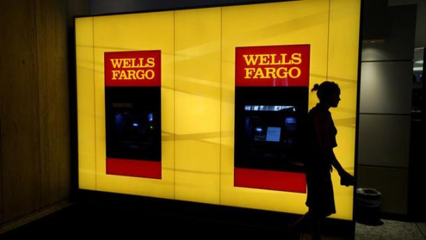 A customer leaves an ATM at the Wells Fargo & Co. bank in downtown Denver April 13, 2016. REUTERS/Rick Wilking - GF10000381813
