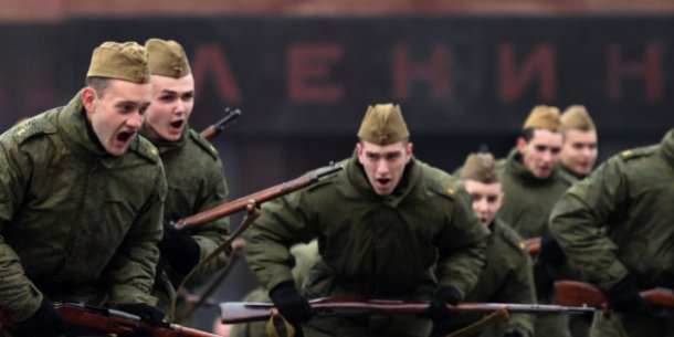 Russian soldiers wearing World War II-era Red Army uniforms take part in a general rehearsal, in Moscow on November 5, 2012, as Russia marks today the 73d anniversary of the 1941 historical parade, when the Red Army soldiers marched to the front line from the Red Square, as Nazi German troops were just a few kilometers away. AFP PHOTO/KIRILL KUDRYAVTSEV